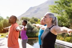 Free Mature Group Of People Doing Breathing Exercise Stock Images - 149551904