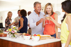 Mature Guests Being Welcomed At Dinner Party By Friends Royalty Free Stock Photography