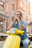 Mature guy sitting on scooter. Thoughtful man on street background. Which direction to ride. Time to improvise Stock Images
