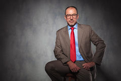 Mature handsome businessman wearing suit and glasses stock images