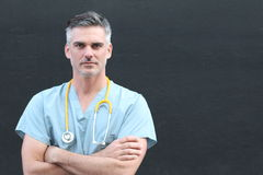 Mature handsome health care worker portrait isolated with arms crossed.  Stock Image
