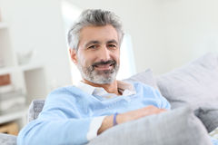 Mature handsome man relaxing at home Royalty Free Stock Image
