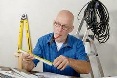 Mature handyman at DIY workshop Royalty Free Stock Photography
