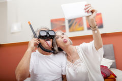 Mature happy couple takes a selfie joking Stock Image