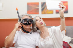 Mature happy couple takes a selfie joking Royalty Free Stock Image