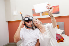 Mature happy couple takes a selfie joking Royalty Free Stock Photography