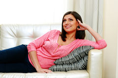 Mature happy smiling woman lying on the sofa Stock Photo