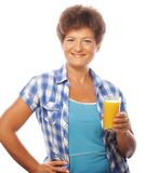 Mature happy woman with orange juice Stock Photography