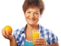 Mature happy woman with orange juice Stock Photo