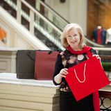 Mature happy woman with shopping bags. Mature happy blonde woman with shopping bags Stock Photo