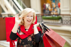Mature happy woman with shopping bags Stock Image