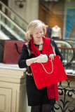 Mature happy woman with shopping bags Royalty Free Stock Photos