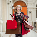 Mature happy woman with shopping bags Royalty Free Stock Photo