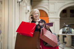 Mature happy woman with shopping bags Stock Photos