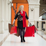 Mature happy woman with shopping bags. Mature happy blonde woman with shopping bags Stock Images