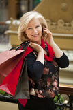 Mature happy woman with shopping bags Stock Photo
