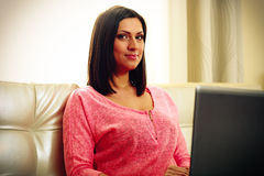 Mature happy woman sitting with laptop Royalty Free Stock Images