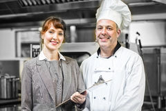 Mature head cook posing with female manager Royalty Free Stock Images