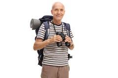 Mature hiker holding a binoculars Stock Image