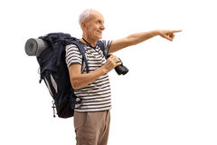 Mature hiker holding binoculars and pointing in the distance. Mature hiker holding a binoculars and pointing in the distance isolated on white background Stock Images