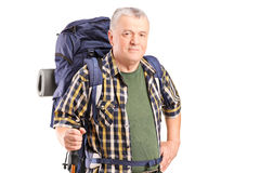 Mature hiker holding a hiking pole Royalty Free Stock Photo