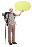 Mature hiker holding a speech bubble Stock Photos