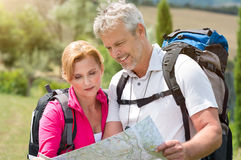 Mature Hiker Looking At Map Stock Photos