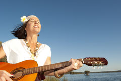 Mature hippie woman with guitar Royalty Free Stock Photography