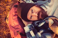 Mature hipster with beard. brutal caucasian hipster with moustache. Bearded man. Confident brutal man relax on camping. Bearded man relax outdoor in sunset stock photo