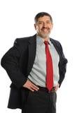 Mature Hispanic Businessman smiling. Mature Hispanic Businessman with hands on his hips and smiling Stock Photos