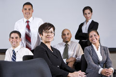 Mature Hispanic businesswoman leading office group Stock Images