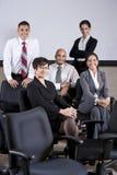 Mature Hispanic businesswoman leading office group Stock Photo