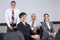 Mature Hispanic businesswoman leading office team Stock Image