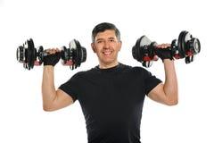Mature Hispanic Man Exercising Stock Photo