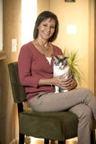 Mature Hispanic woman holding a cat Royalty Free Stock Images
