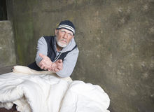 Mature homeless man looking fed up, holding out his hands Royalty Free Stock Photos