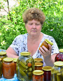 Mature housewife with canned food for the winter Stock Photo