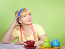 Mature housewife drinking tea or coffee Royalty Free Stock Images