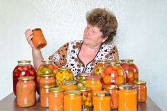 Mature housewife with home canned vegetables Stock Image