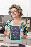 Mature housewife woman with curlers Stock Photo