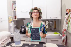 Mature housewife woman with curlers Royalty Free Stock Images