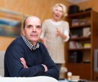 Mature husband tired of yelling wife Stock Photo