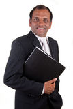 Mature indian business man with folder smiling Stock Images