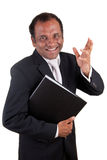Mature indian business man with folder smiling. Portrait of a mature smiling indian business man with folder stock image
