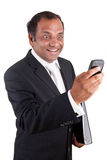 Mature indian business man with phone and folder Stock Photography