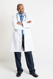 Mature Indian doctor full length Stock Images