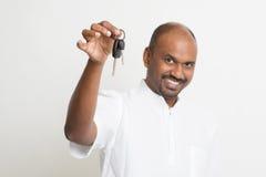 Mature Indian man holding car key stock images