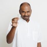 Mature Indian man holding house key Stock Photo