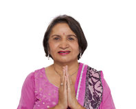 Mature indian woman namaste greeting Stock Images
