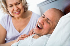 Mature irritated woman disturbed with partner snores Stock Photography